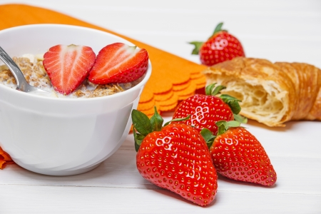 healthy fresh breakfast - cereal with strawberries photo