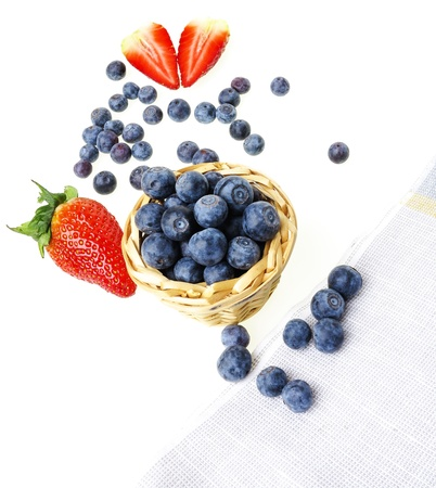 blueberries in a little basket on a white background photo