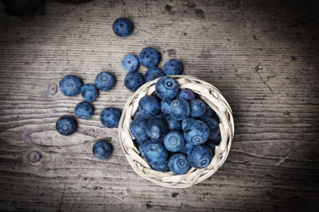 fresh blueberries on an old table - still life photo