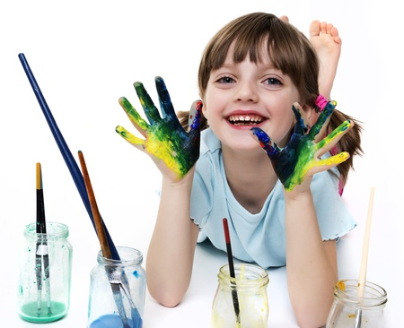 happy little girl playing with colors Stock Photo