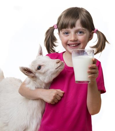smiling goat: little girl drinking healthy goat milk Stock Photo