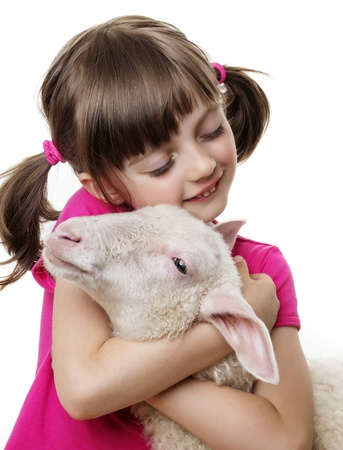 cute young farm girl: little girl with a lamb Stock Photo