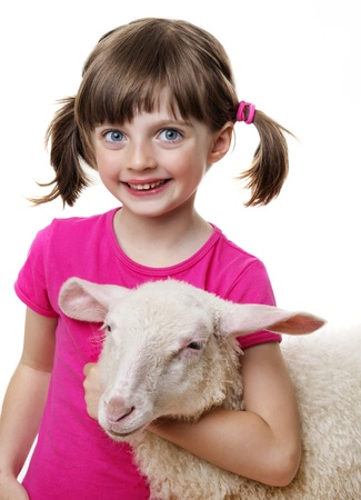 happy little girl with a lamb photo