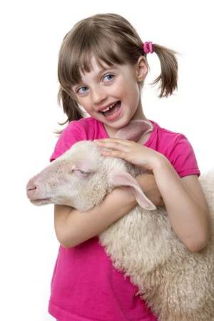 little girl with a sheep isolated on a white background photo