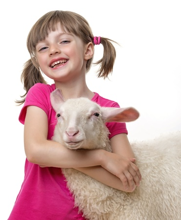 a happy little girl with a sheep  photo