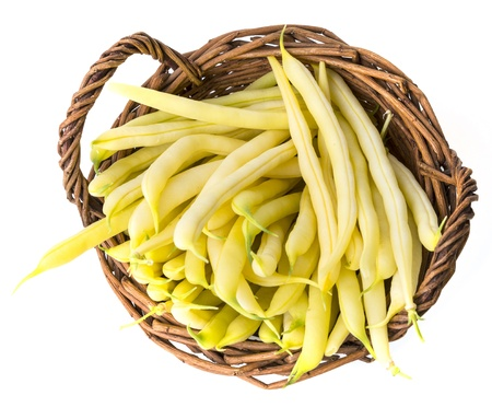 yellow beans in a basket -  isolated on a white background Stock Photo - 20416472