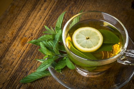 mint tea on an old wooden table photo