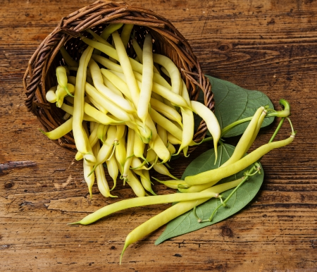 yellow beans in a basket -  a  wooden background Stock Photo - 20447564