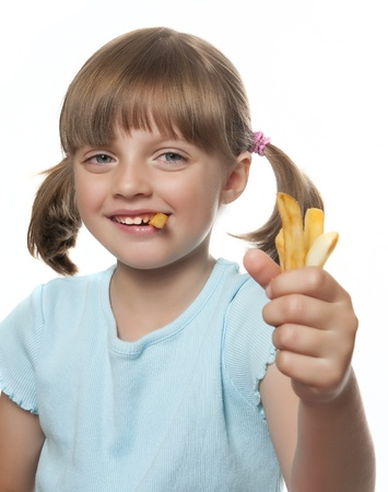 happy little girl eating french fries photo
