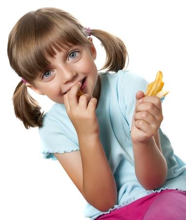 little girl eating: a little girl eating french fries