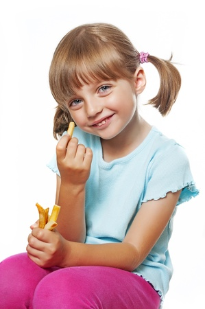 cute little girl eating french fries photo