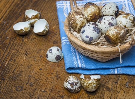 quail eggs in a basket on a table photo