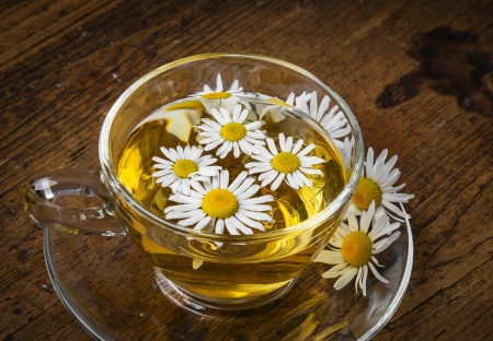 chamomile tea on a wooden table photo
