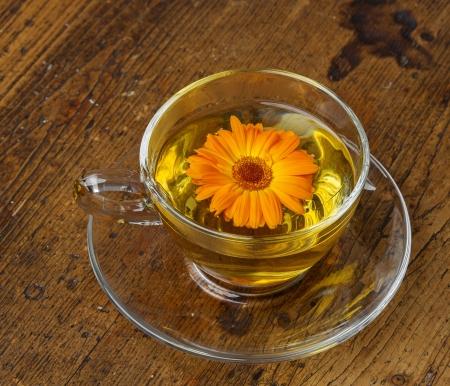 marigold tea on an old wooden table photo