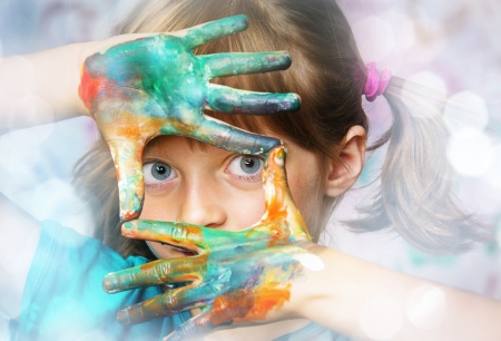 little girl playing with water colors