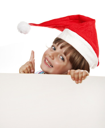 little girl with santa cap holding  white board photo