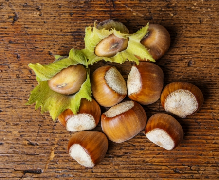 hazelnuts on a wooden table photo