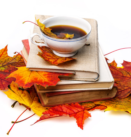 still life with autumn leaves, books and tea photo