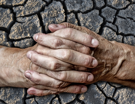 old senior hands and dry ground photo