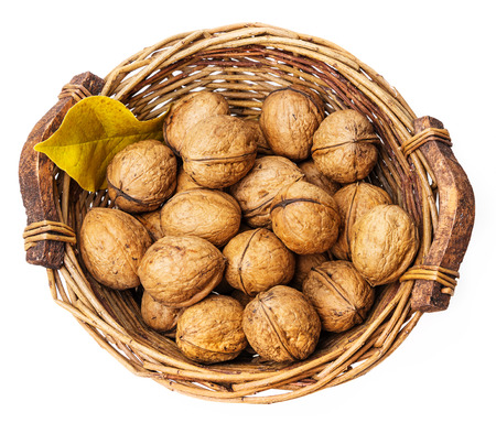 a basket with walnuts on white background photo