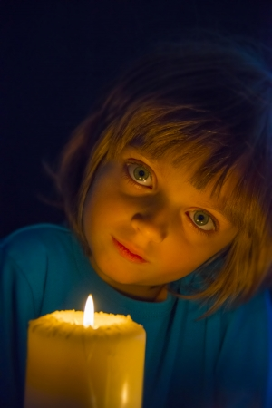 little girl with a big candle photo