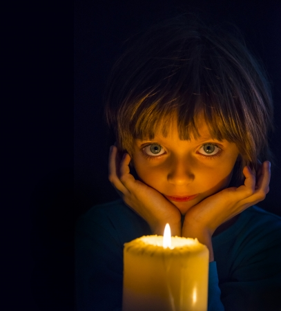 sad little girl with a candle photo