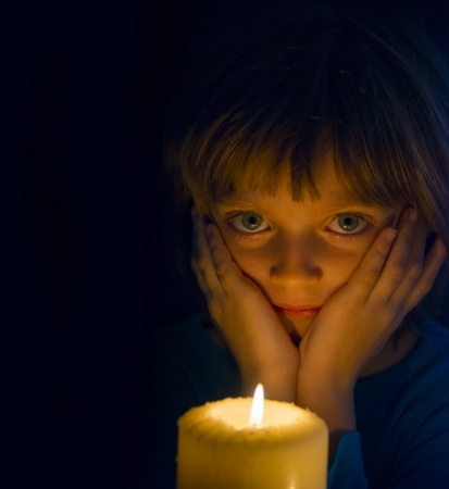 little girl with a candle photo