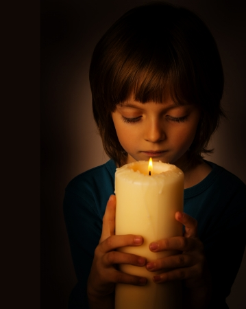 girl with a big candle photo