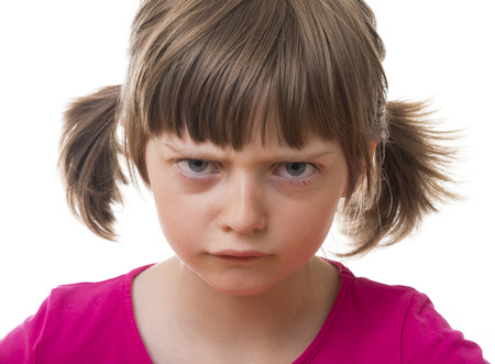 angry little girl on white background photo