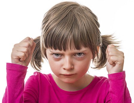 sensible: angry little girl on white background Stock Photo