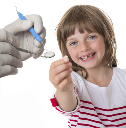 happy little girl pointing her missing teeth in her hand Stock Photo