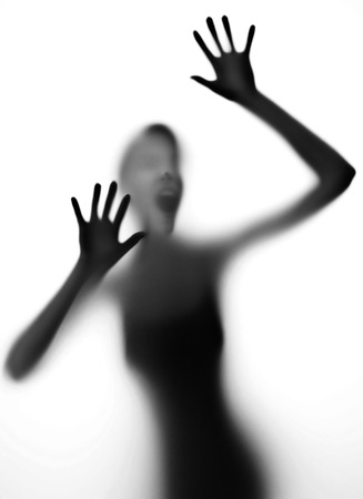 silhuette of a screaming woman - danger concept photo