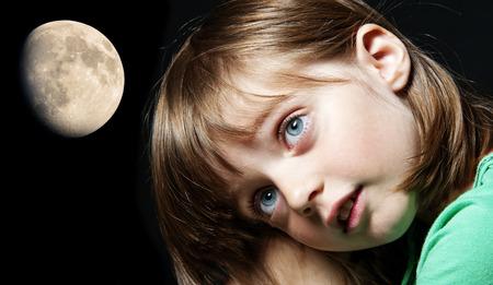 sleepwalking: little girl and moon - bad dreams Stock Photo
