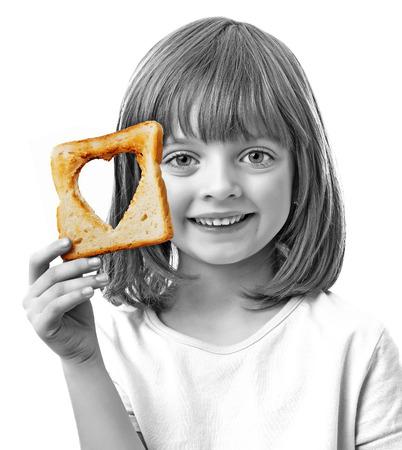 little girl holding  bread on white background photo