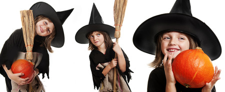 little witch holding a pumpkin on halloween time photo