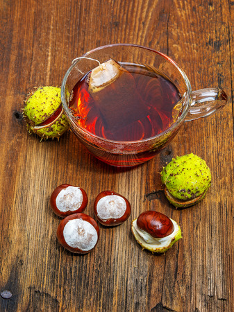 autumnal tea with chestnuts photo