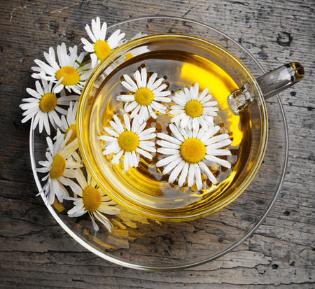 chamomile tea on an old wooden table photo