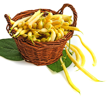 yellow beans in a basket -  a white background photo
