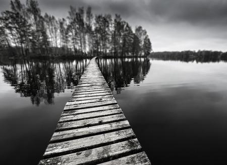 wooden path on a lake photo