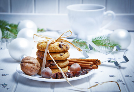 christmas still life with biscuits and a cut of tea photo