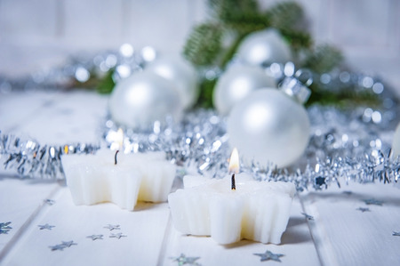 christmas still life with two candles photo