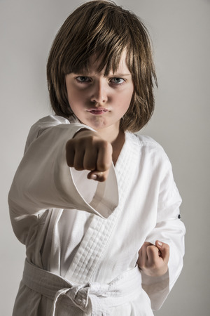 karate: a little girl practicing karate Stock Photo