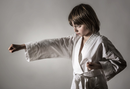 a little girl practicing karate Stock Photo
