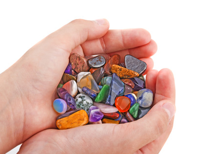 semiprecious: hand with collection of semiprecious natural stones