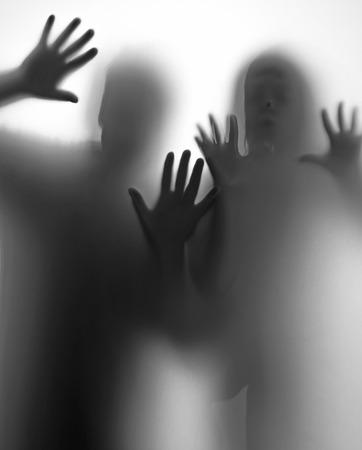people shadow: shadow of people behind transparent paper