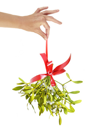 mistletoe: a hand holding christmas mistletoe