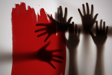 shadow of a hands behind transparent paper Stock Photo