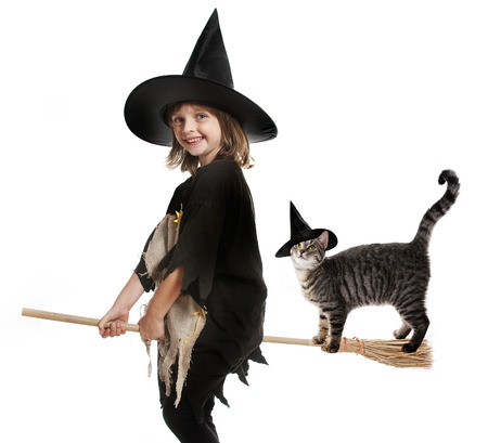 hallowen: little hallowen witch flying on broom  with her cat
