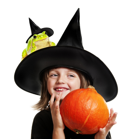 little witch holding a pumpkin on halloween time