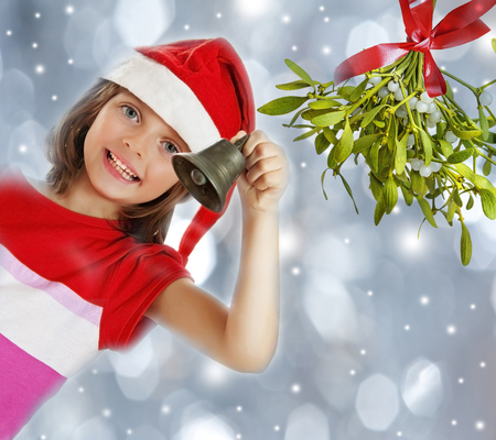 little bell: little girl with christmas bell - snowfall background Stock Photo